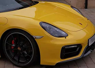 Photograph of the front of a yellow Porsche Car